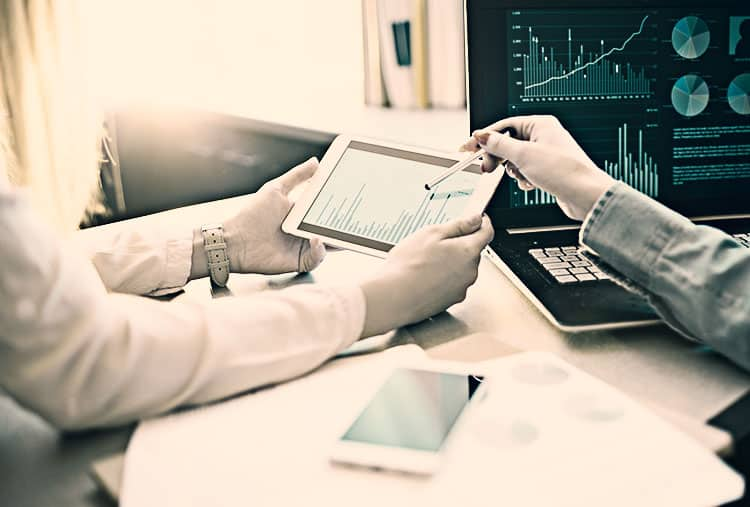 Business people reviewing cash flow data
