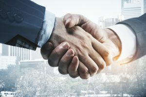 shaking hands when buying a business