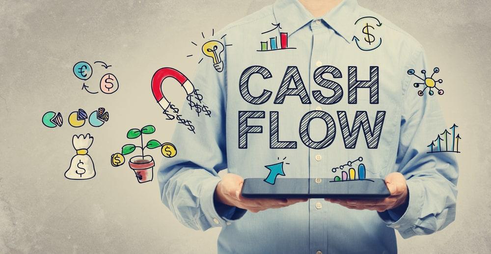 cash flow - man holding tablet computer