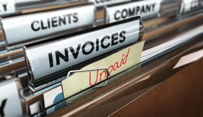 invoice folder with a note that says unpaid